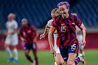 SAITAMA, JAPAN - JULY 24: Megan Rapinoe #15 of the United States bursts clear during a game between New Zealand and USWNT at Saitama Stadium on July 24, 2021 in Saitama, Japan.
