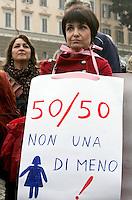 """""""Se non le donne chi? Se non ora quando?"""": manifestazione per il rispetto della dignita' e dei diritti delle donne, a Roma, 11 dicembre 2011..Women attend the """"If not women who? If not now, when?"""" rally to ask for respect of their dignity and rights, in Rome, 11 december 2011. The sign reads """"Not one less""""..UPDATE IMAGES PRESS/Riccardo De Luca"""
