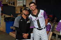 """Akron RubberDucks Gianpaul Gonzalez (left) and Nolan Jones (17) before an Eastern League game against the Erie SeaWolves on August 30, 2019 at Canal Park in Akron, Ohio.  Akron wore special jerseys with the slogan """"Fight Like a Kid"""" during the game for Akron Children's Hospital Home Run for Life event, the design was created by 11 year old Macy Carmichael.  Erie defeated Akron 3-2.  (Mike Janes/Four Seam Images)"""