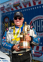 Sep 2, 2019; Clermont, IN, USA; NHRA funny car driver John Force poses for photos as he celebrates after winning the US Nationals at Lucas Oil Raceway. Mandatory Credit: Mark J. Rebilas-USA TODAY Sports