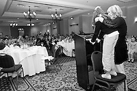Jane Hughes and her daughter Amy introduce themselves at the Share and Care Network's annual retreat held at the Doubletree Guest Suites Hotel in Boston on May 20, 2006. <br /> <br /> The Share and Care Network was created in 1981 by Pat Cahill when her son Scott was diagnosed with Cockayne Syndrome.  A rare form of dwarfism, Cockayne Syndrome is a genetically determined condition whose symptoms include microcephaly, mental retardation, progressive blindness, progressive hearing loss, premature aging, and a shortened lifespan averaging 18 years.  Those afflicted have distinctive facial features, including sunken eyes, pinched faces, and protruding jaws as well as distinctive gregarious, affectionate personalities.<br /> <br /> Because of the rarity of the condition (1/1,000 live births) and its late onset (characteristics usually begin to appear only after one year), many families and physicians are often baffled by children whose health begins to deteriorate after normal development.  It was partly with this in mind that the Share and Care Network was formed, to promote awareness of this disease as well as to provide a support network for those families affected.  In 1998 it began organizing an annual retreat, which has grown from three families in its inaugural year to more than 30 today.  Although the retreat takes place in the United States, families from as far as Japan arrive for this one weekend out of the year to share information and to support one another.
