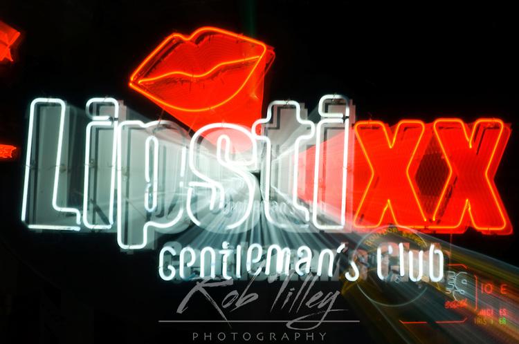 Louisiana, New Orleans, Bourbon Street, Lipstixx Neon Sign (Zoom Blur)