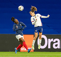 LE HAVRE, FRANCE - APRIL 13: Kelley O'Hara #5 of the USWNT heads the ball during a game between France and USWNT at Stade Oceane on April 13, 2021 in Le Havre, France.