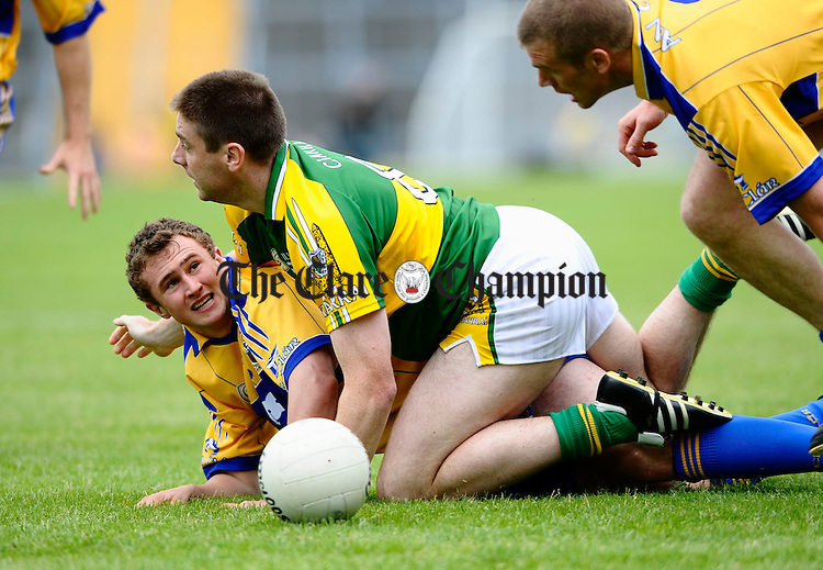 Clare's David Connole and Kerry's Darragh O Se get tangled during their senior championship game in Killarney. Photograph by John Kelly.