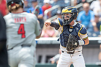 Michigan Wolverines catcher Joe Donovan (0) directs traffic during Game 11 of the NCAA College World Series against the Texas Tech Red Raiders on June 21, 2019 at TD Ameritrade Park in Omaha, Nebraska. Michigan defeated Texas Tech 15-3 and is headed to the CWS Finals. (Andrew Woolley/Four Seam Images)