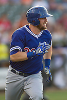 Oklahoma City Dodgers designated hitter Andy Wilkins (38) runs to first base during the Pacific Coast League baseball game against the Round Rock Express on June 9, 2015 at the Dell Diamond in Round Rock, Texas. The Dodgers defeated the Express 6-3. (Andrew Woolley/Four Seam Images)