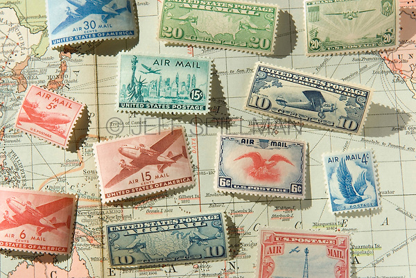 Old United States of America Airmail Postage Stamps and 1930 World Map<br /> <br /> AVAILABLE FOR COMMERCIAL OR EDITORIAL LICENSING FROM PLAINPICTURE.COM.  Please go to www.plainpicture.com and search for image # p569m791802.