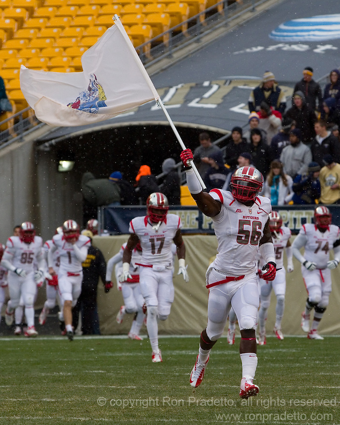 Marvin Booker waves the New Jersey flag. The Pitt Panthers defeat the Rutgers Scarlet Knights 27-6 on Saturday, November 24, 2012 at Heinz Field , Pittsburgh, PA.