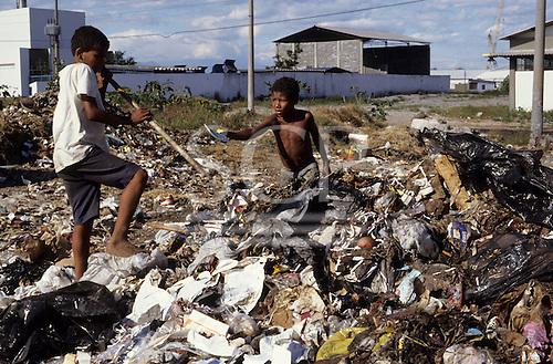 Rio de Janeiro, Brazil; Children sorting through rubbish at the municipal rubbish dump.