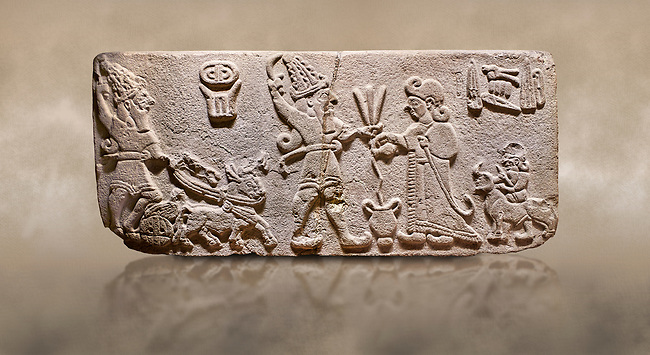 """Aslantepe Hittite Orthostat. Limestone, Aslantepe, Malatya, 1200-700 B.C. <br /> <br /> Scene of offering drink and sacrifice. The god, with a symbol of divinity above, is in the chariot while holding a boomerang in his hand and a sword at his waist. The same god holds a lightning bundle in the middle. On the right, the king offers a drink to god. The inscription above reads """"Great, powerful King Sulumeli"""". A servant stands behind holding a bull for sacrifice to the gods. Anatolian Civilisations Museum, Ankara, Turkey.<br /> <br /> Against a brown art background."""