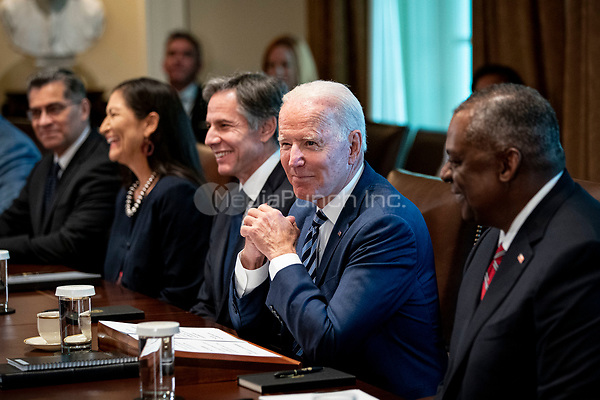 United States President Joe Biden pauses before speaking during a cabinet meeting at the White House in Washington, D.C., U.S., on Tuesday, July 20, 2021. Biden administration officials say they're starting to see signs of relief for the global semiconductor supply shortage, including commitments from manufacturers to make more automotive-grade chips for car companies.   Pictured from left to right: US Secretary of Health and Human Services Xavier Becerra, US Secretary of the Interior Debra Haaland, US Secretary of State Antony Blinken, President Biden, US Secretary of Defense Lloyd J. Austin III.<br /> Credit: Al Drago / Pool via CNP /MediaPunch
