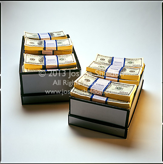 Shoe boxes filled with stacks of $100 bills
