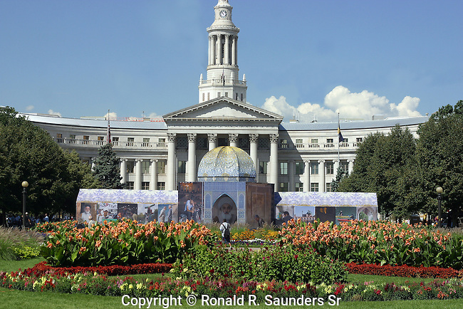 PHOTOS ARE DISPLAYED IN THE IRANIAN PAVILION AT A FAIR IN COLORADO IN FRONT OF THE CITY AND COUNTY BUILDING
