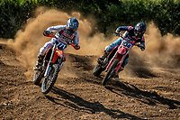 Oliver Beamish and Junior Thomas battle it out at the front of the race during the Richard Fitch Memorial Trophy Motocross at Wakes Colne MX Circuit on 18th July 2021