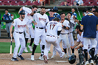 Wisconsin Timber Rattlers players celebrate a walk-off win during a game against the West Michigan Whitecaps on May 22, 2021 at Neuroscience Group Field at Fox Cities Stadium in Grand Chute, Wisconsin.  (Brad Krause/Four Seam Images)
