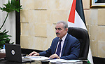 Palestinian Prime Minister Mohammed Ishtayeh speaks during the launch of the First National Conference for Social Dialogue and the National Employment Strategy, via a video link in the West Bank city of Ramallah, on March 3, 2021. Photo by Prime Minister Office