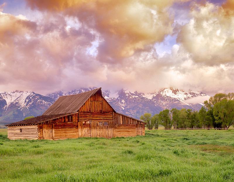 Old barn at sunrise with Teton Mountains. Teton National Park, Wyoming