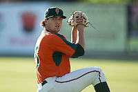 Greensboro Grasshoppers starting pitcher Michael Mader (15) warms up in the outfield prior to the game against the Kannapolis Intimidators at CMC-Northeast Stadium on June 11, 2015 in Kannapolis, North Carolina.  The Intimidators defeated the Grasshoppers 7-6.  (Brian Westerholt/Four Seam Images)