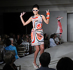 A model walks the runway at the Salvation Army Women's Auxiliary Luncheon and Fashion Show at the River Oaks Country Club Tuesday April 13,2010. (Dave Rossman Photo)