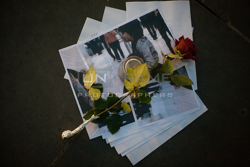 Printouts and a rose on the pavement at Place de la République after a small group of people took part in a silent tribute to Shaimaa El-Sabagh who was shot dead by police at a march organized by her leftist party, called Popular Alliance, in Cairo on Saturday January 24th. Photos widely distributed show Shaimaa El-Sabagh, bloody, held up by a fellow protestor following the shooting. Paris, France. Jan. 27, 2015.