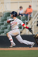 Michael Chavis (11) of the Greenville Drive follows through on his swing against the Kannapolis Intimidators at Intimidators Stadium on June 7, 2016 in Kannapolis, North Carolina.  The Drive defeated the Intimidators 4-1 in game one of a double header.  (Brian Westerholt/Four Seam Images)