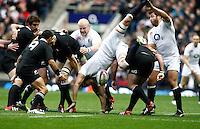 Photo: Richard Lane/Richard Lane Photography. England v New Zealand. QBE Autumn Internationals. 01/12/2012. England's Tom Wood comes crashing down at a lineout.