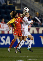 Lindsay Tarpley (5) of the USWNT goes up for a header with Sun Ling (15) of China during an international friendly at PPL Park in Chester, PA.  The U.S. tied China, 1-1.