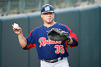 Humberto Quintero (35) of the Tacoma Rainiers before the game against the Salt Lake Bees in Pacific Coast League action at Smith's Ballpark on July 9, 2014 in Salt Lake City, Utah.  (Stephen Smith/Four Seam Images)