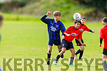 St Brendans Park's Shane O'Donovan controls the ball under pressure from Aaron Folan of Dingle Bay Rovers in the U13 Division 1 soccer league.