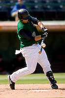Charlotte Knights catcher Gustavo Molina makes solid contact in game action versus the Indianapolis Indians at Knights Stadium in Fort Mill, SC, Sunday, August 13, 2006.
