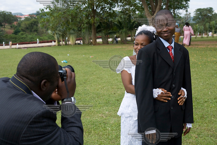 A newly wed Ibo couple pose for a photographer in Abuja's Millennium Park.
