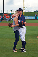Tampa Yankees pitcher Andrew Schwaab (34) hugs his fiancé Lauren Stoeckle after proposing before the Florida State League All-Star Game on June 17, 2017 at Joker Marchant Stadium in Lakeland, Florida.  FSL North All-Stars defeated the FSL South All-Stars  5-2.  (Mike Janes/Four Seam Images)