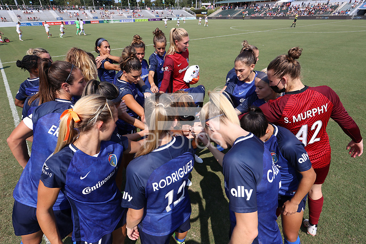 CARY, NC - SEPTEMBER 12: North Carolina Courage players huddle before a game between Portland Thorns FC and North Carolina Courage at Sahlen's Stadium at WakeMed Soccer Park on September 12, 2021 in Cary, North Carolina.