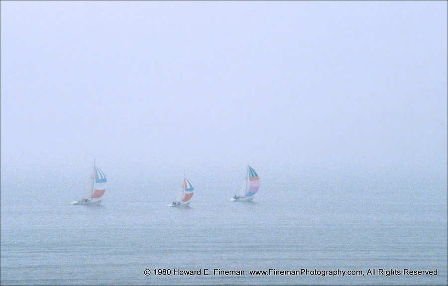 Mist at Antibes, 3 sailboats visible in light fog from the seawall at Grimaldi Castle.