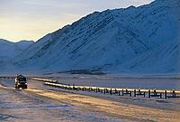 The trans Alaska oil pipeline, truck on the James Dalton Highway (Haul Road) Atigun Canyon, Brooks Range, Arctic, Alaska.