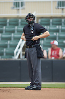 Home plate umpire Tanner Moore adjusts his chest protector during the South Atlantic League game between the Greensboro Grasshoppers and the Piedmont Boll Weevils at Kannapolis Intimidators Stadium on June 16, 2019 in Kannapolis, North Carolina. The Grasshoppers defeated the Boll Weevils 5-2. (Brian Westerholt/Four Seam Images)