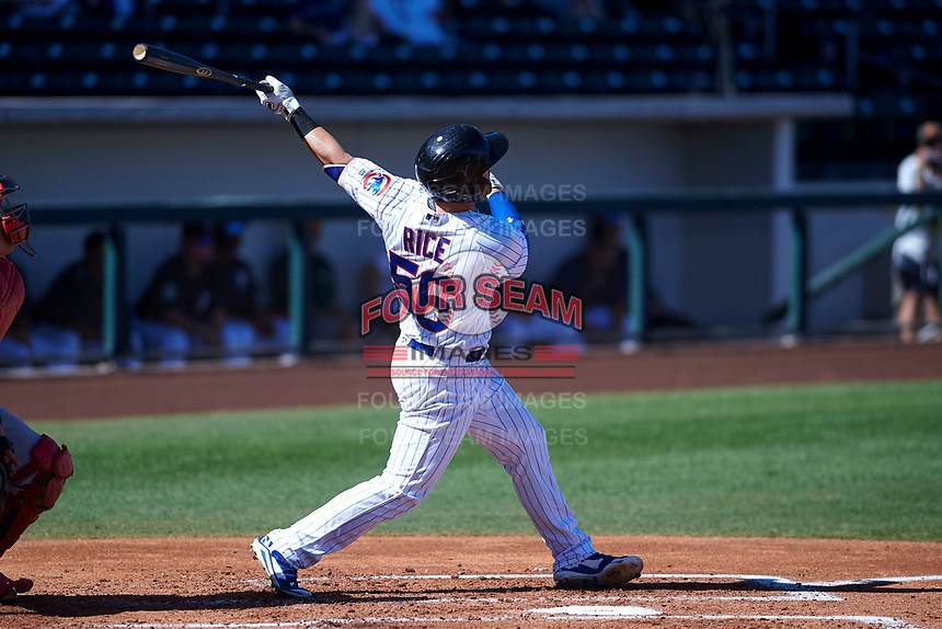 Mesa Solar Sox first baseman Ian Rice (56), of the Chicago Cubs organization, follows through on his swing during an Arizona Fall League game against the Peoria Javelinas on October 25, 2017 at Sloan Park in Mesa, Arizona. The Solar Sox defeated the Javelinas 6-3. (Zachary Lucy/Four Seam Images)