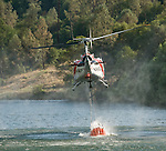 CalFire Helicopter 404 dips water from the Mokelumne River during the Middle Bar Fire.