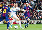 Toni Kroos (C) of Real Madrid fights for the ball with Lionel Andres Messi (R) and Andres Iniesta Lujan of FC Barcelona during the La Liga 2017-18 match between FC Barcelona and Real Madrid at Camp Nou on May 06 2018 in Barcelona, Spain. Photo by Vicens Gimenez / Power Sport Images