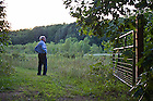Aug, 23, 2013; Architect and owner, Edward Noonan '53 gazes out to a meadow during sunset at Tryon Farm in Michigan City, IN.  Photo by Barbara Johnston/University of Notre Dame
