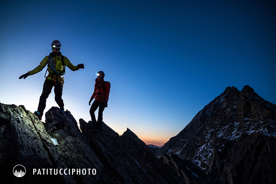 Two climbers on their way to the Weissmies south ridge at dawn, using headlamps, Switzerland