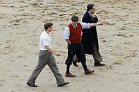 Pictured: Will Poulter, Conieth Hill. Friday 18 June 2021<br /> Re: Film set with a scene being filmed with Hugh Laurie as a director at Three Cliffs Bay in the Gower Peninsula, Wales, UK.