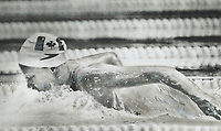 1976 FILE PHOTO - ARCHIVES -<br /> <br /> More hope in pool: Wendy Quirk of Pointe Claire; Quebec; churns to a third-place over-all finish in semi-finals of 100-metre butterfly yesterday; qualifying to battle the formidable Kornelia Ender and 2 East German team-mates in final. Canada's female swimmers have given their country its only medals so far -- 3 bronze -- and are expected to be in close contention for more this week.<br /> 1976<br /> <br /> PHOTO : Boris Spremo - Toronto Star Archives - AQP