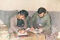 Iran 1987 .In Dizli, near Merivan,Mahmoud Sangawy, right, working in a room .Iran 1987 .A droite Mahmoud Sangawy travaillant dans une chambre a Dizli pres de Merivan