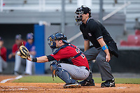 Elizabethton Twins catcher A.J. Murray (22) catches a pitch as home plate umpire Nick Susie looks on during the game against the Kingsport Mets at Hunter Wright Stadium on July 8, 2015 in Kingsport, Tennessee.  The Mets defeated the Twins 8-2. (Brian Westerholt/Four Seam Images)