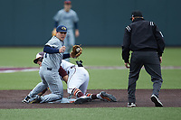 Luke Waddell (7) of the Georgia Tech Yellow Jackets looks for the call from second base umpire Ryan Clark as Nick Biddison (24) of the Virginia Tech Hokies slides into second base at English Field on April 17, 2021 in Blacksburg, Virginia. (Brian Westerholt/Four Seam Images)