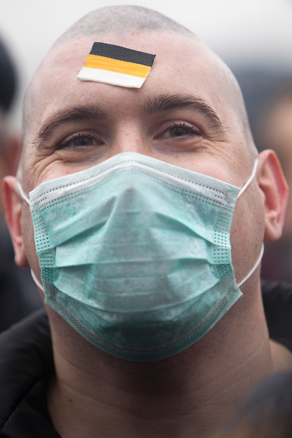 Moscow, Russia, 04/11/2010..A masked demonstrator with a Russian nationalist flag on his forehead, one of some 7,000 from the Movement Against Illegal Immigration and other ultra-nationalist groups as they march in Moscow. The demonstration, called the Russian March, was organised to mark the National Unity Day holiday, which has replaced the old holiday celebrating the Bolshevik Revolution, and which extremist nationalist groups have tried to make their own.