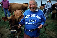 Anne Burke, who has 30 years experience showing animals, shows off her heifer at the Tunbridge Fair in Vermont.