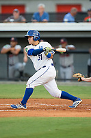 Jesus Atencio (31) of the Burlington Royals follows through on his swing against the Danville Braves at Burlington Athletic Stadium on August 12, 2017 in Burlington, North Carolina.  The Braves defeated the Royals 5-3.  (Brian Westerholt/Four Seam Images)