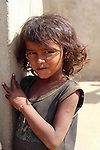 This young girl lived with her family in a compound of villagers who made lacquered enamelware.